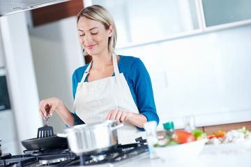 Small pic woman cooking with spices